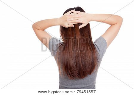 Back Of Young Asian Woman Put Hands On Head