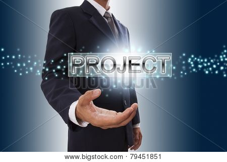 Businessman hand showing project button.