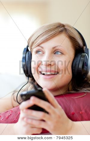 Caucasian Woman Is Listening The Music In The Living-room