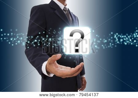 Businessman hand showing question mark icon .