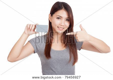 Young Asian Woman Point To Blank Card