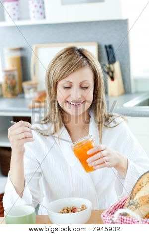 Cute Woman Having A Breakfast In The Kitchen
