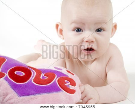 portrait of naked baby with a heart