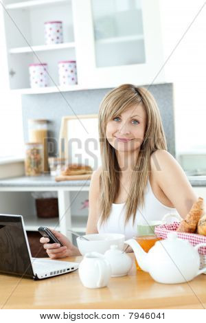 Cute Woman Having Breakfast In The Kitchen