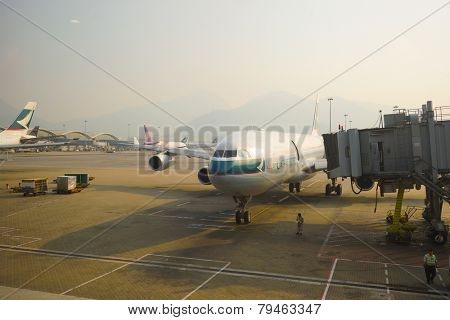 HONG KONG - OCT 17: aircraft near boarding bridge in airport on October 17, 2014 in Hong Kong. Cathay Pacific is the flag carrier of Hong Kong, with its main hub at Hong Kong International Airport.
