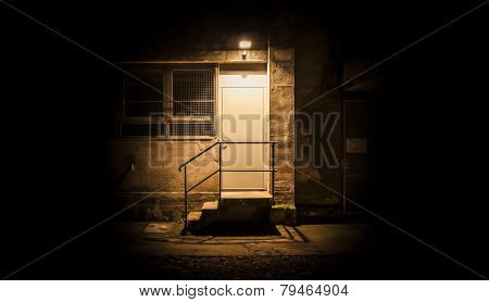 Stairs And Door Illuminated In The Night