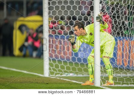 KLAGENFURT, AUSTRIA - MARCH 05, 2014: Heinz Lindner (#12 Austria) directs his defense in a friendly soccer game between Austria and Uruguay.
