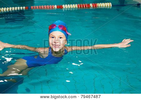 School Girl Swims In The Sports Pool