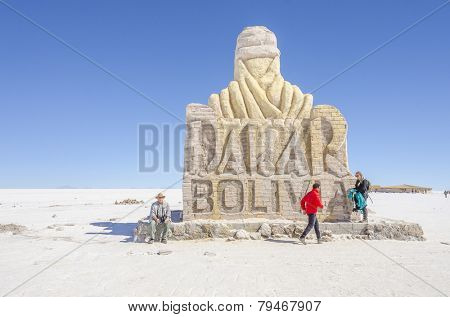 SALAR DE UYUNI, BOLIVIA, MAY 15, 2014: Tourists visit The Dakar Bolivia Monument made from salt bricks