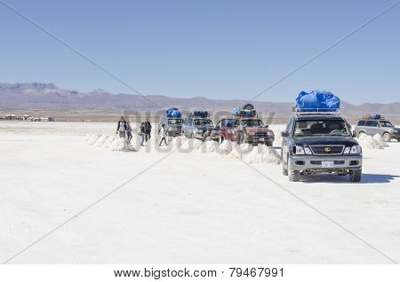 SALAR DE UYUNI, BOLIVIA, MAY 15, 2014: Tourists visit Salar de Uyuni during organized tours in 4 by 4 cars