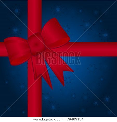 Red Bow & Ribbon Over A Blue Snowflake Background