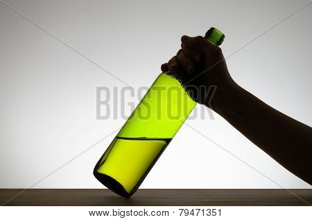 Female Hand Grabbing A Bottle