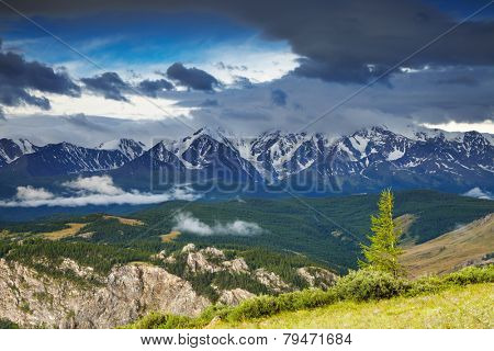 Landscape with snowy mountains and cloudy sky