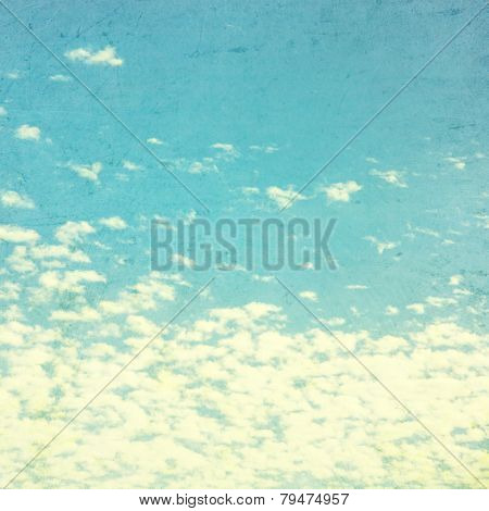 Blue vintage sky with fluffy clouds