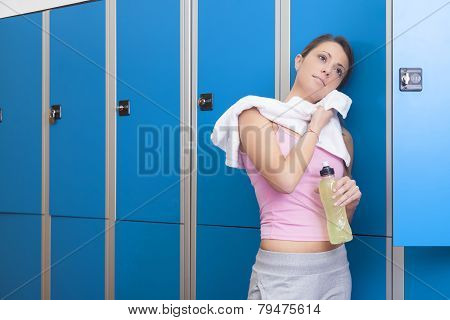 Fitness Young Smiling Woman Resting In Blue Dressing Room