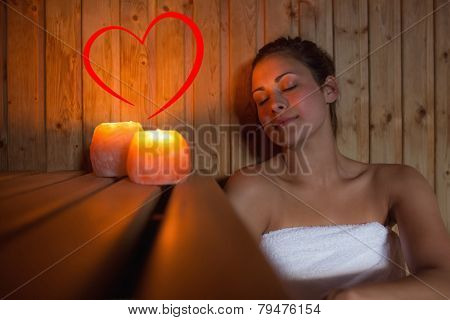 Happy brunette woman sitting in a sauna against heart
