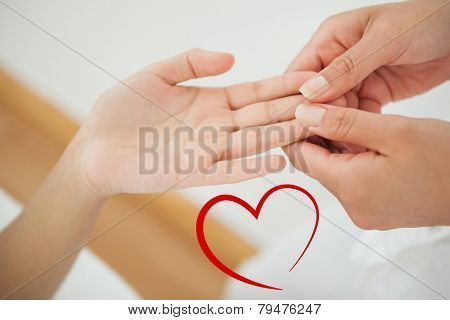 Woman receiving a hand massage against heart