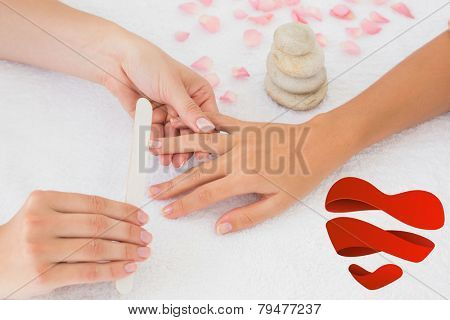 Nail technician filing customers nails against heart