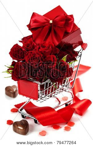 A shopping cart full with roses, chocolate and gift - Valentine's day and love concept