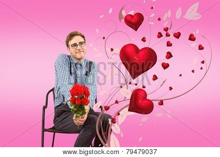 Geeky hipster holding a bunch of roses against pink