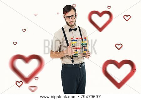 Geeky hipster holding an abacus against hearts