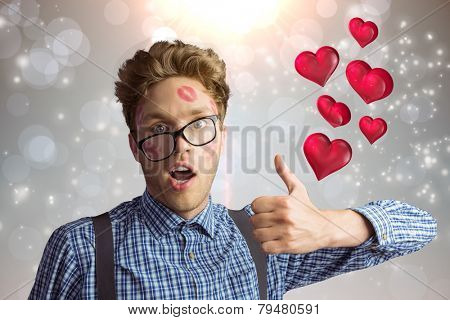 Geeky hipster covered in kisses against grey design with white stars