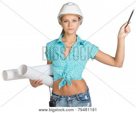Beautiful girl in white helmet holding scrolls drawings and ballpoint pen indicates to right