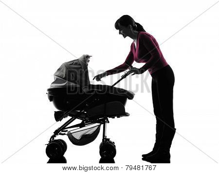 one  woman prams baby silhouette on white background