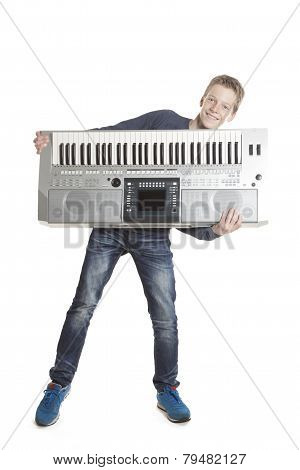 Teenage Boy Has Fun With Keyboard In Studio