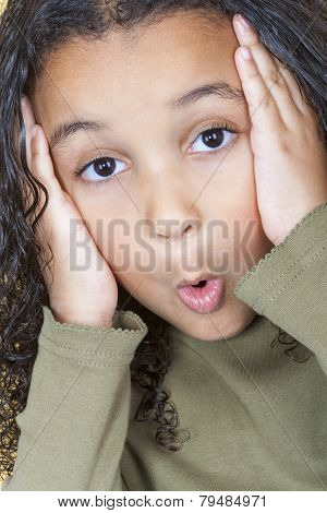 A beautiful mixed race African American little girl female child looking surprised or shocked