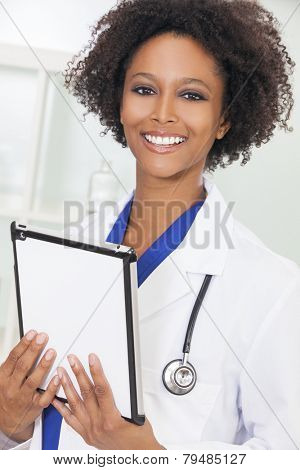 A black African American female medical doctor using a tablet computer in a hospital