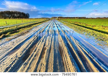 Muddy Sand Lane In Landscape On Sunny Day