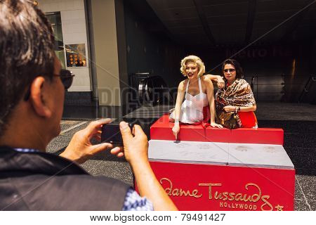 Tourist Taking Photo With Marilyn Monroe