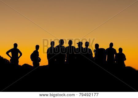 People Silhouettes At Sunset