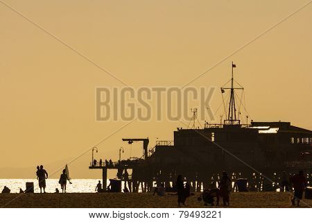 Silhouettes Of People At Santa Monica