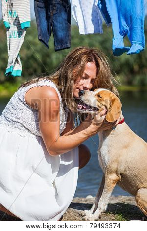 Pregnant Woman Caressing Dog