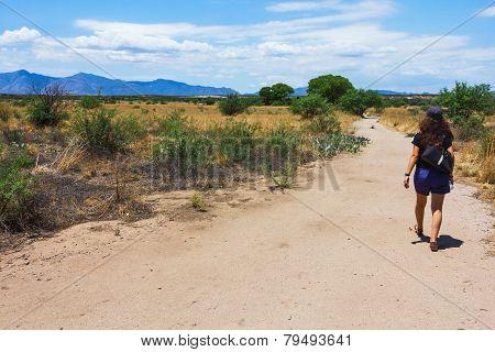 Girl Walking Through Desert Field