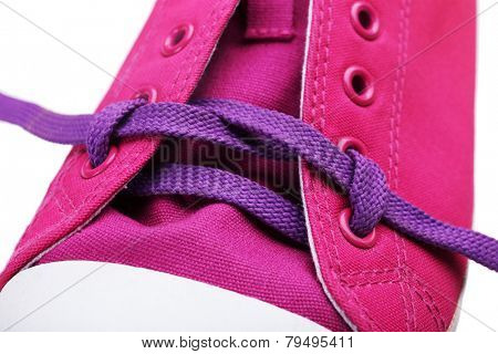 Process of tying shoelace, close-up