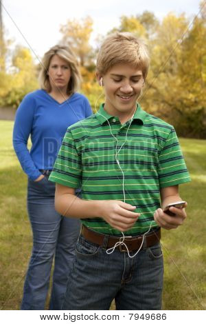 Son Ignoring Mother Listening to Portable Music Player
