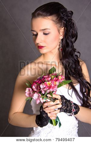 Portrait Of A Young Beautiful Fiancee With A Bunch Of Pink Flowers