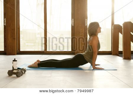 Fit Woman Doing Yoga Positions in a Yoga Studio