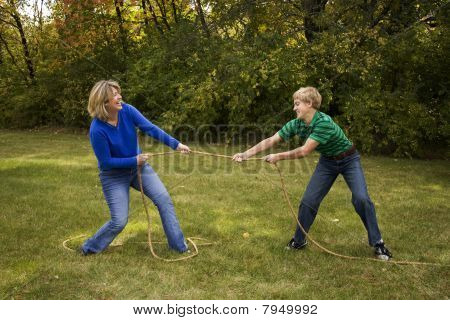 Mother and Son Tug of War outdoors