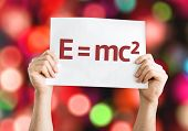 E = mc2 card with colorful background with defocused lights poster