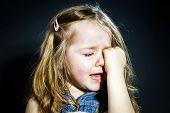 Постер, плакат: Crying Blond Little Girl With Focus On Her Tears