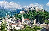 stock photo of mozart  - Hohensalzburg Fortress and cathedral in Salzburg - JPG