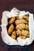 stock photo of baked raisin cookies  - Whole wheat rosemary cookies with raisin in a box - JPG