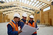 picture of purlin  - A team of builders discuss the plans for a major construction job - JPG