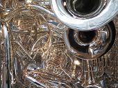 stock photo of trombone  - Many brass horns in a tangle: tubas, trombones, trumpets, and bugle