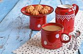 picture of milkman  - Drink brown red old ceramic mug against the milkman and biscuits - JPG