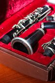 foto of clarinet  - clarinet wind instrument disassembled and placed in the case - JPG